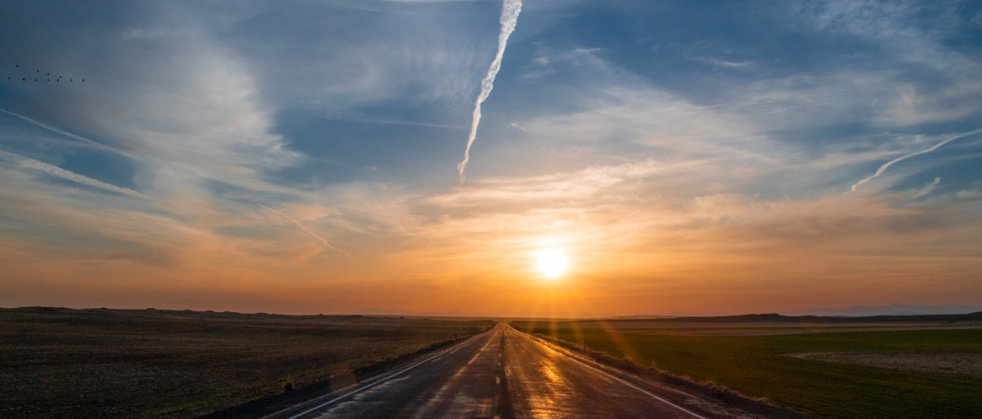 Highway at sunset near Waterville